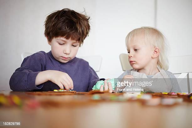 Children decorating gingerbread cookies