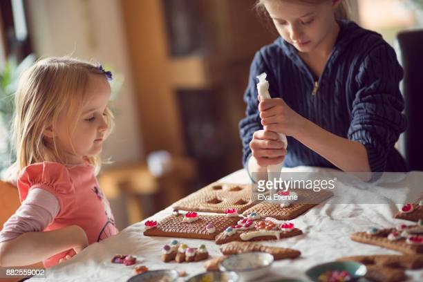 Children decorating gingerbread houses