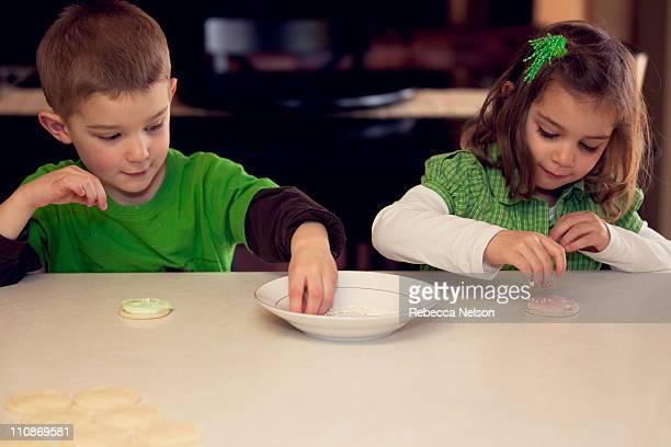 Children decorating sugar cookies