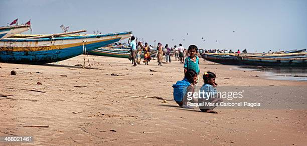 Children defecating on the beach