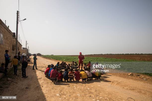 Children displaced from Efrin play in the field with the Syrian Red Crescent volunteers in Ahras An estimated 400000 refugees fleeing the twomonthold...