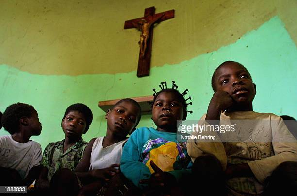 MARCH 2003 Children displaced in Angola's brutal 27year civil war attend a mass in the town of Cazombo Peace revealed one of the worst nutritional...
