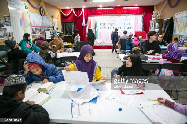 Children do homework during a tutoring session at the Rohingya Cultural Center of Chicago on January 10 2019 in Chicago Illinois Chicago has one of...
