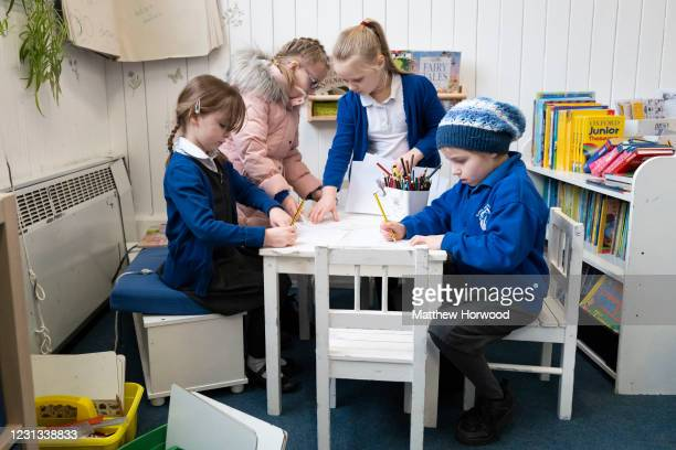Children do some drawing in a classroom at Roath Park Primary School on February 23, 2021 in Cardiff, Wales. Children aged three to seven began a...
