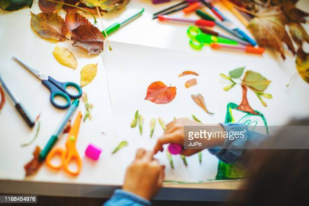 children doing autumn handcrafts - art and craft stock pictures, royalty-free photos & images