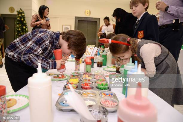 Children doing holiday arts and crafts as Brooks Brothers celebrates the holidays with St Jude Children's Research Hospital on December 12 2017 in...