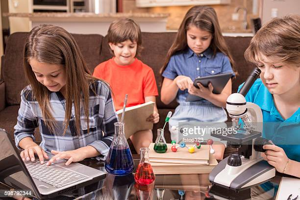 Children doing science homework at home.