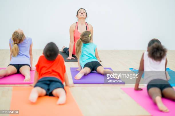 Children Doing Yoga in a School Gym