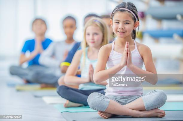 children doing yoga - childhood stock pictures, royalty-free photos & images