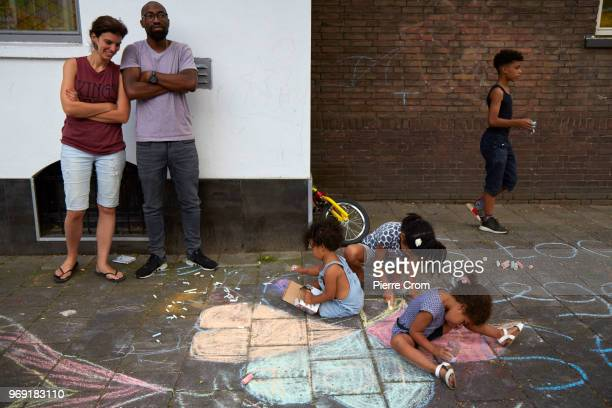 Children draw hearts on the pavement outside the Laleli Mosque on June 7 2018 in Rotterdam NetherlandsThe antiIslam group Pegida plans to roast pigs...