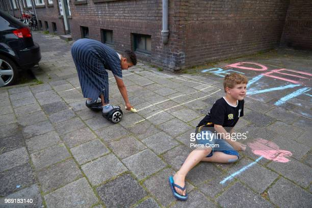 Children draw on the pavement outside the Laleli Mosque on June 7 2018 in Rotterdam NetherlandsThe antiIslam group Pegida plans to roast pigs on a...