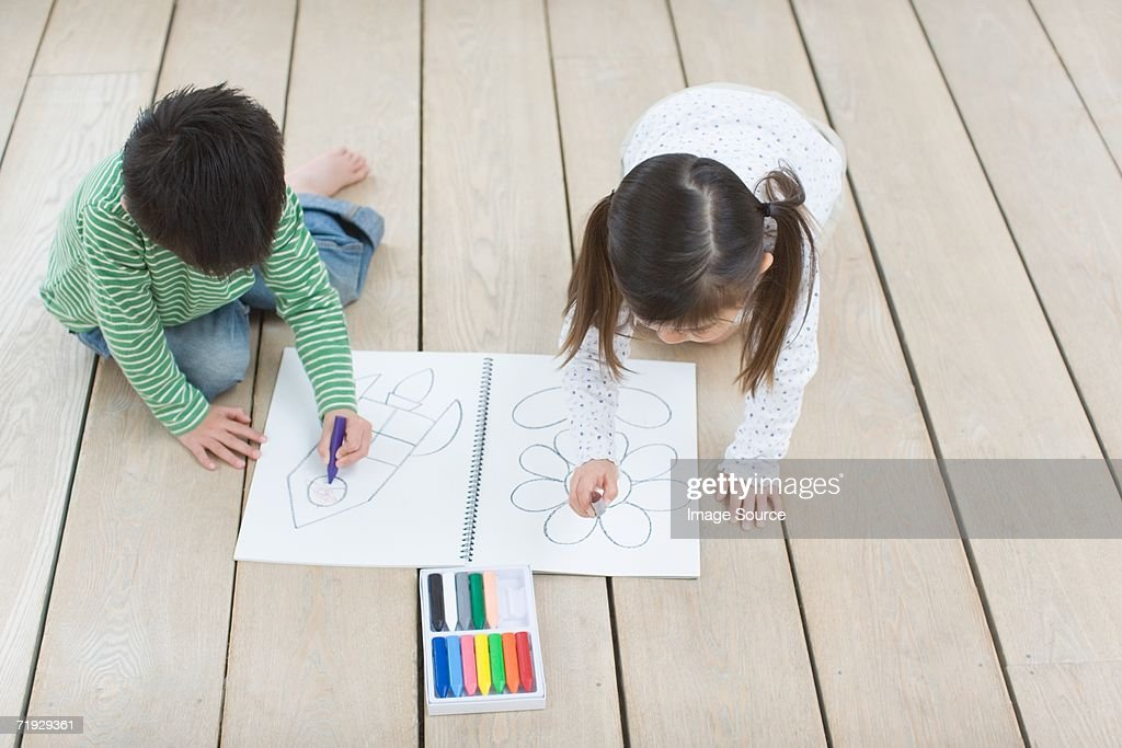 Children drawing with crayons : Stock Photo
