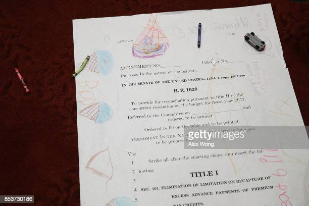 Children drawings are seen on an enlarged page one of the American Health Care Act of 2017 during a news conference on health care September 25 2017...