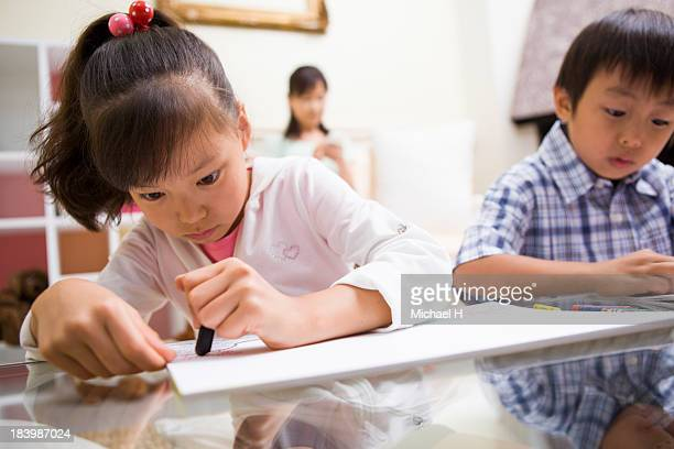Children drawn picture with grandma at home