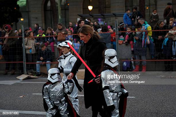 Children dress as Stormtroopers as they wait for the start of the 'Cabalgata de Reyes' or the Three Kings parade on January 5 2016 in Madrid Spain...