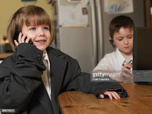 children dressed as business people - adult imitation stock pictures, royalty-free photos & images