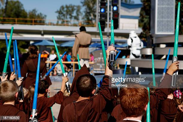 Children dressed as Jedis hold light sabers during the Star Wars Jedi Training Academy at Walt Disney Co's Disneyland Park part of the Disneyland...