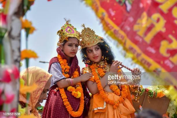 SRINAGAR JAMMU KASHMIR INDIA Children dressed as Krishna and Radha consort of Lord krishna poses during rally procession on occasion of Janamashtami...