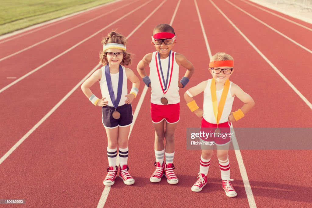 Children Dressed as Nerds at Track Wearing Medals : Stock Photo