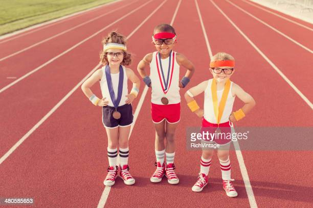 children dressed as nerds at track wearing medals - the olympic games stock pictures, royalty-free photos & images