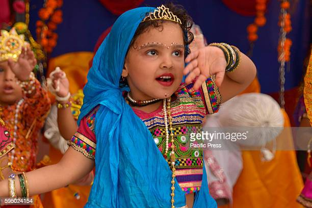 Children dressed as Radha and dance in a religious procession on the occasion of Janamashtami in Ajmer Rajasthan India