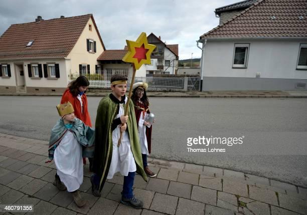 Children dressed as the three kings Balthasar Melchior and Gaspar go Epiphany caroling on January 5 2014 in EkenbachAlsenborn near Kaiserslautern...