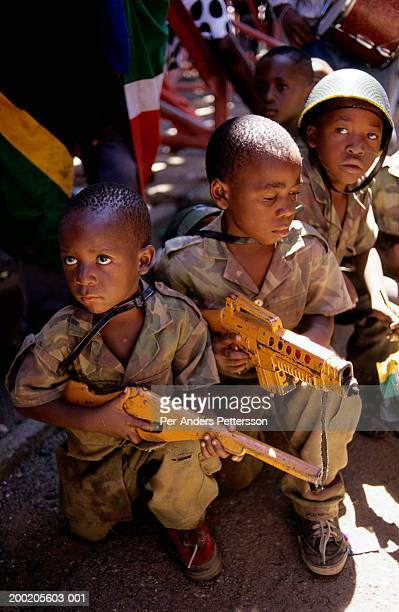 children dressed in military uniforms parade during election rally in south africa - per-anders pettersson stock pictures, royalty-free photos & images