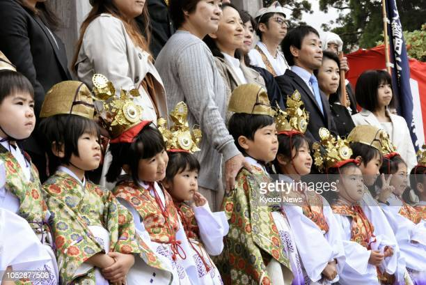 Children dressed in traditional attire pose with their parents at Daisenji a Buddhist temple in Tottori Prefecture western Japan on Oct 24 after...