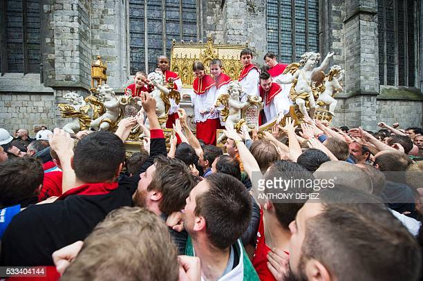 Children dressed like priests parade during the Ducasse de Mons or Doudou festival in Mons on May 22 2016 The Doudou feast compromises two parts a...