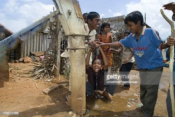 Children drinking from water pump