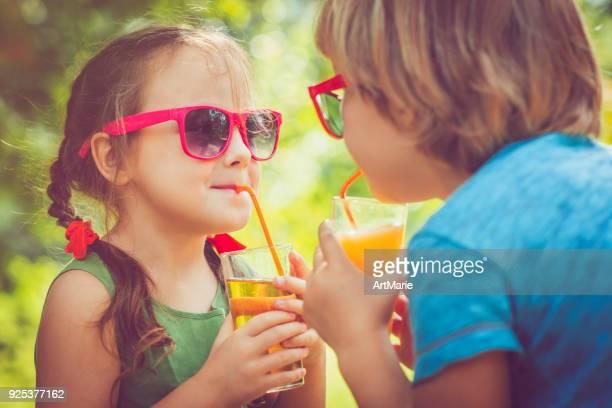 Children drinking juice