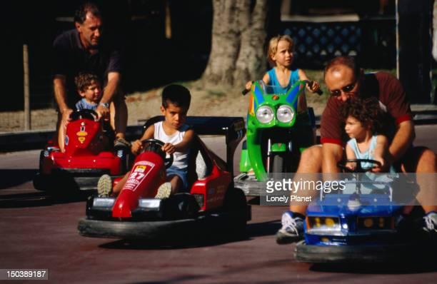 Children driving bumper-cars in Parco Sempione.