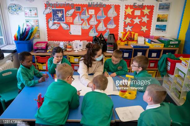 Children during a lesson at Bryn Hafod Primary School on March 2, 2021 in Cardiff, Wales. Children aged three to seven began a phased return to...