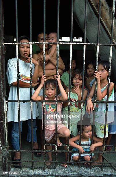 Children during visiting hours at Batang City Jail, one of four gangs at the Manila City Jail. Some of the children even live with their fathers in a...