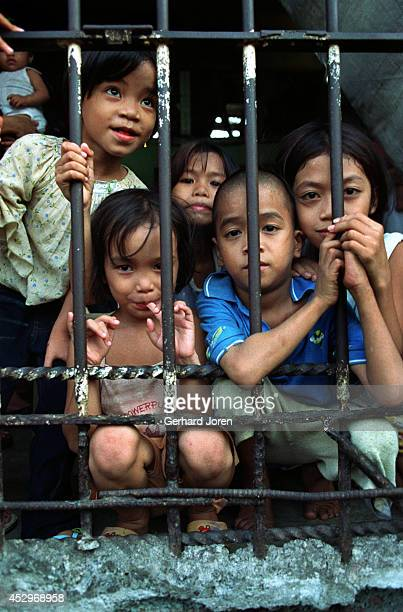 Children during visiting hours at Batang City Jail one of four gangs at the Manila City Jail Some of the children even live with their fathers in a...