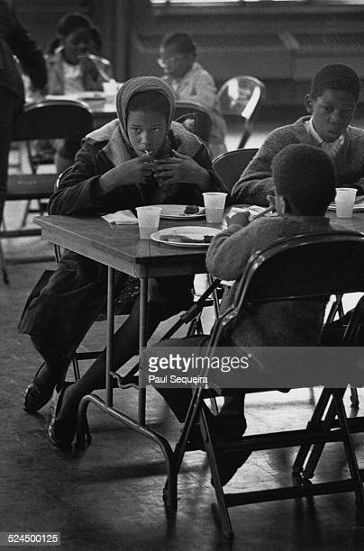 Children eat and are served meals at a Black Panther Free Breakfast for Children Program Chicago Illinois 1969