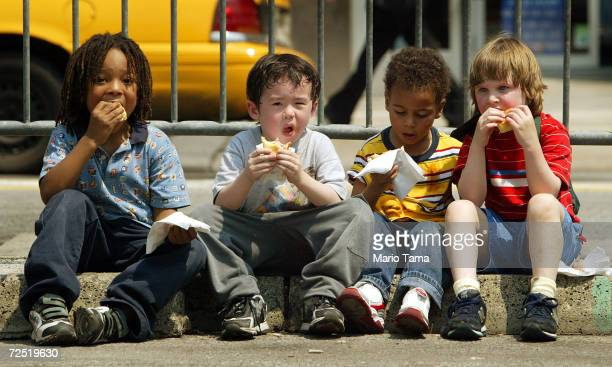 Children eat free Oscar Meyer Wiener hot dogs in Union Square at a kickoff event announcing the Oscar Meyer 'Oh I Wish' contest May 11 2004 in New...