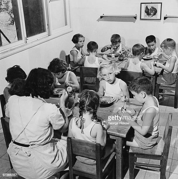 Children eating a meal in their own dining room at the Givat Brenner Kibbutz Israel circa 1950
