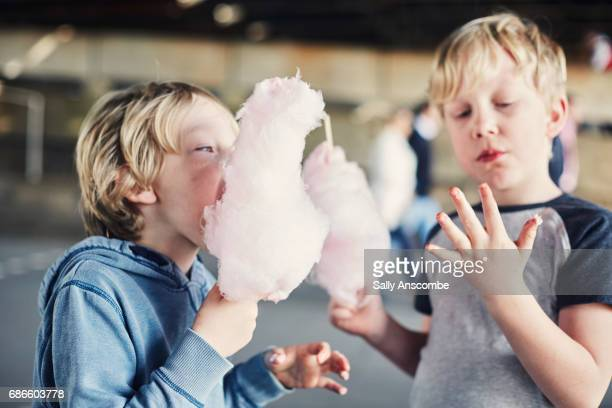 Children eating candy floss