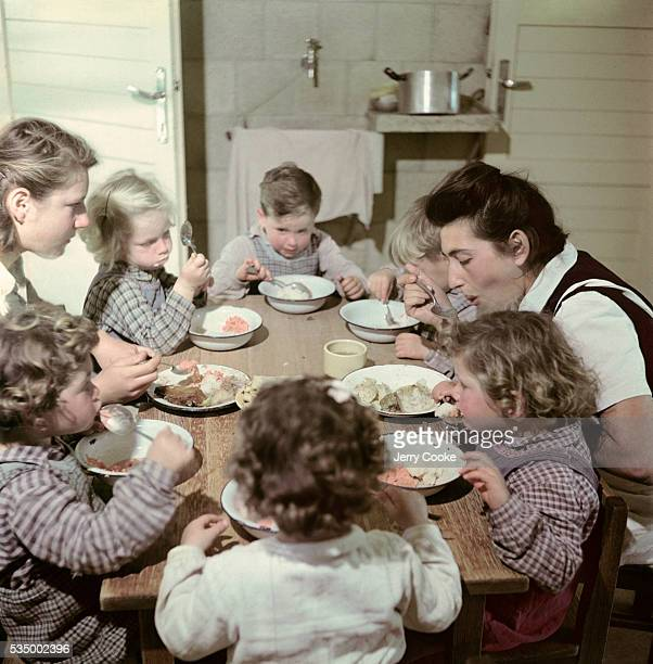 Children Eating Dinner with Their Nurses in a Kibbutz