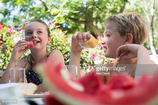 Children eating healthy breakfast outside