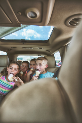 Children eating ice cream cones in the car - gettyimageskorea