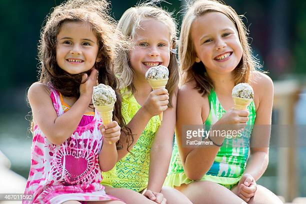 children eating ice cream - standing water stock pictures, royalty-free photos & images