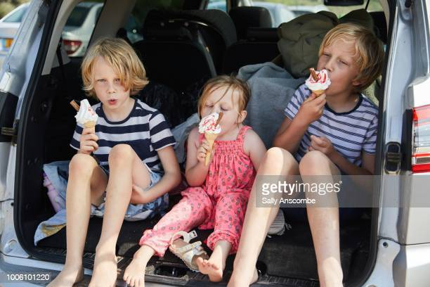 Children eating ice cream together