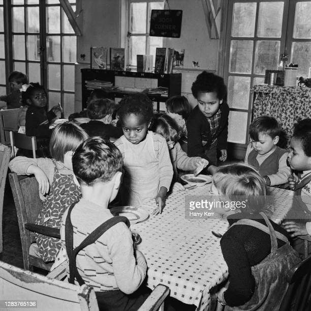 Children eating lunch at the Brixton Day Nursery on Coldharbour Lane in Brixton, south London, 1955. Four years earlier there were no Black children...