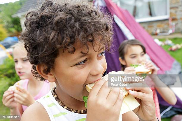 Children eating sandwiches in garden