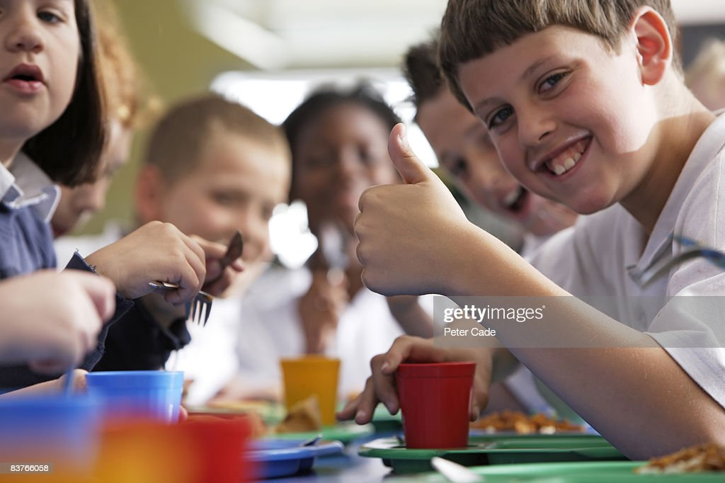 children eating school dinner : Stock Photo