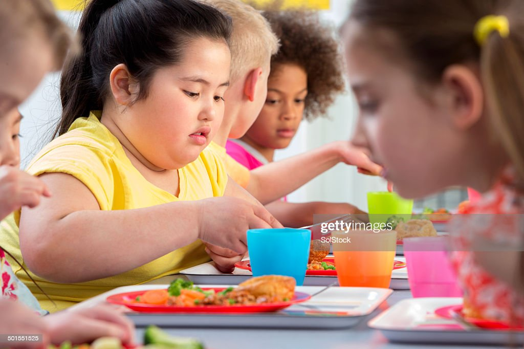 Children Eating School Dinners : Stock Photo