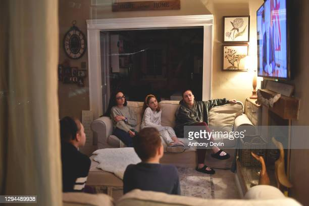 Children Emily, Eryn, Ewen, Gwen and Olivia watch Prime Minister Boris Johnson make a televised announcement on January 04, 2021 in Manchester,...