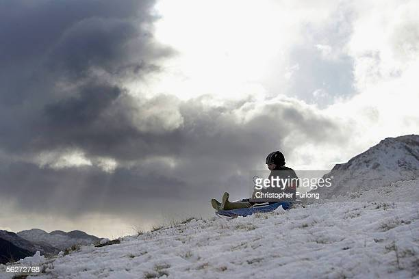 Children enjoy a day off school sledging after the first major snowfall of winter on 25 November 2005 Capel Curig Wales Many parts of the UK were hit...